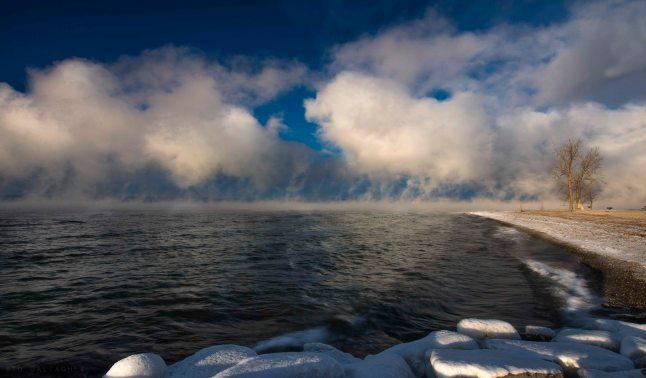 Clouds lifting off Seneca Lake in the warming sun